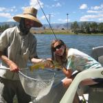 Happy young angler on the Yellowstone river